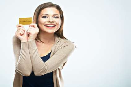 Happy woman hold credit card. White background isolated.